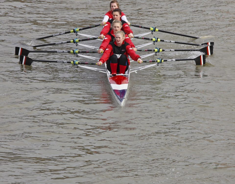 Bristol, England - February 20, 2011: Team of young women rowing to the start point of the annual river race through Bristol docks